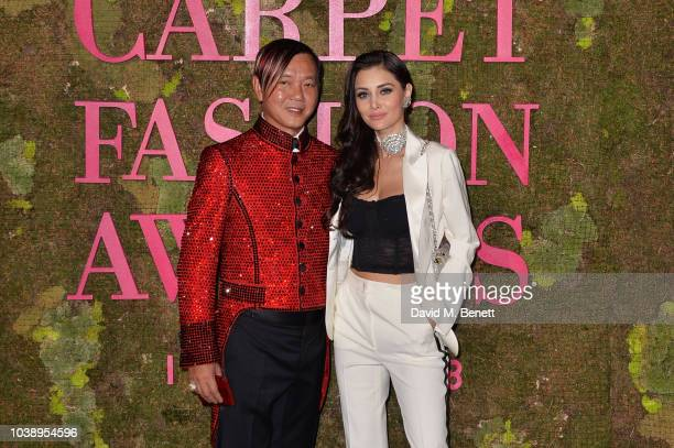 Stephen Hung and Deborah Valdez attend The Green Carpet Fashion Awards Italia 2018 at Teatro Alla Scala on September 23 2018 in Milan Italy
