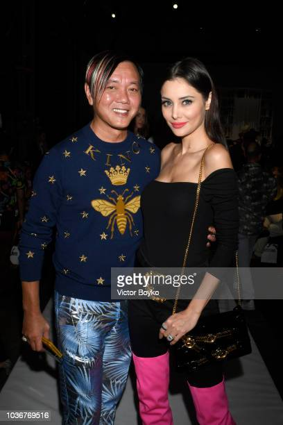 Stephen Hung and Deborah Valdez Hung attend the Moschino show during Milan Fashion Week Spring/Summer 2019 on September 20 2018 in Milan Italy