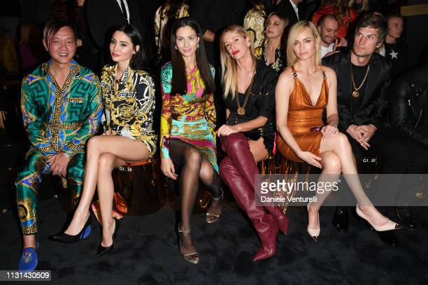 Stephen Hung Deborah Hung Marica Pellegrinelli Alessia Marcuzzi Amber Valletta and Teddy Charles attend the Versace show at Milan Fashion Week...