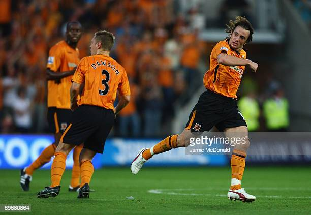 Stephen Hunt of Hull celebrates his goal during the Barclays Premier League match between Hull City and Tottenham Hotspur at the KC Stadium on August...