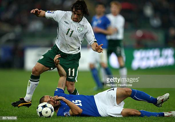 Stephen Hunt of Ireland battles with Andrea Dossena of Italy during the FIFA 2010 World Cup Qualifier between Italy and The Republic of Ireland in...