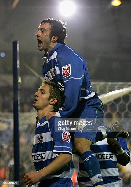 Stephen Hunt of Reading jumps on the shoulders of goalscorer Kevin Doyle during the FA Cup Third Round match between West Bromwich Albion and Reading...