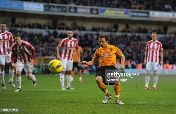 Stephen Hunt of Wolves scores a penalty to make it 10 during the Barclays Premier League match between Wolverhampton Wanderers and Stoke City at...