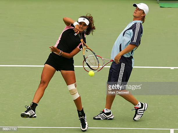 Stephen Huss of Australia and Sania Mirza of India in action in their doubles match against Bob Bryan of the USA and and Vera Zvonera of Russia...