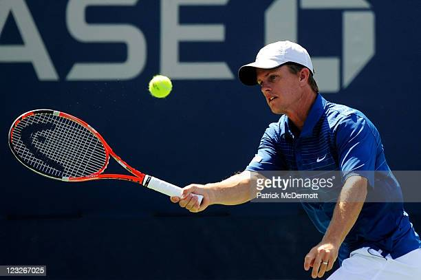 Stephen Huss of Australia returns a shot during his doubles match with Ashley Fisher of Australia against Martin Emmrich of Germany and Andreas...