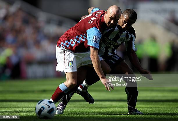 Stephen Ireland of Aston Villa holds off a challenge from Wayne Routledge of Newcastle United during the Barclays Premier League match between...