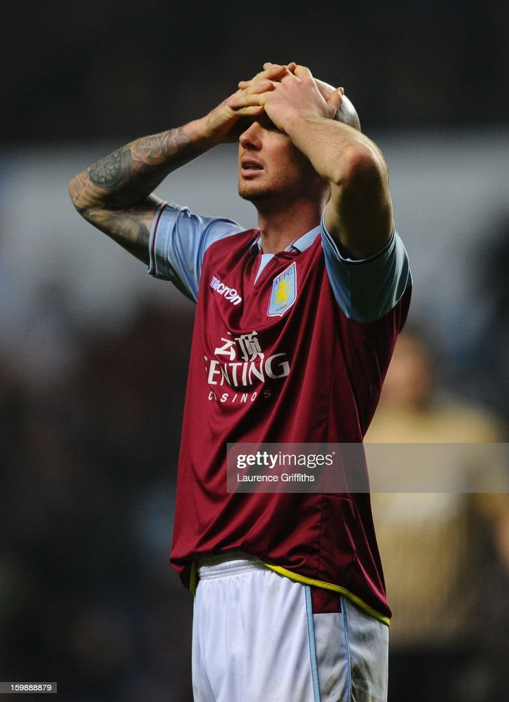 Stephen Ireland of Aston Villa shows his dejection at the end of the Capital One Cup Semi-Final Second Leg between Aston Villa and Bradford City at Villa Park on January 22, 2013 in Birmingham, England.