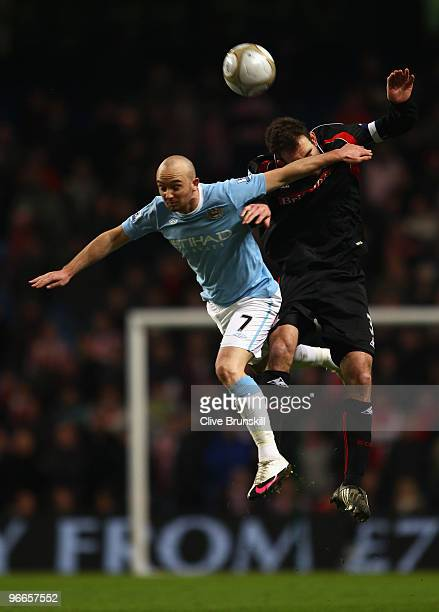 Stephen Ireland of Manchester City goes up for a header with Danny Higginbotham of Stoke City during the the FA Cup sponsored by EON Fifth round...
