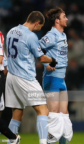 Stephen Ireland of Manchester City pulls down his shorts to celebrate after scoring the first goal