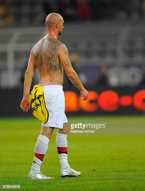 Stephen Ireland of Manchester City walks off displaying tattoos showing angel wings after losing 31 at Borussia Dortmund