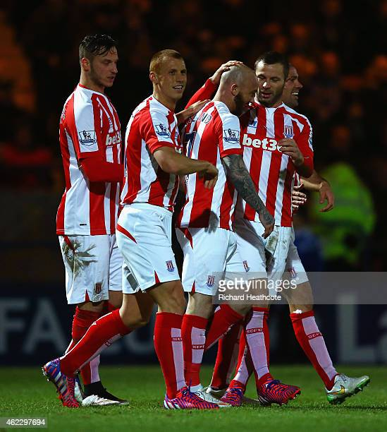 Stephen Ireland of Stoke City celebrates with team mates after scoring their second goal during the FA Cup fourth round match between Rochdale and...