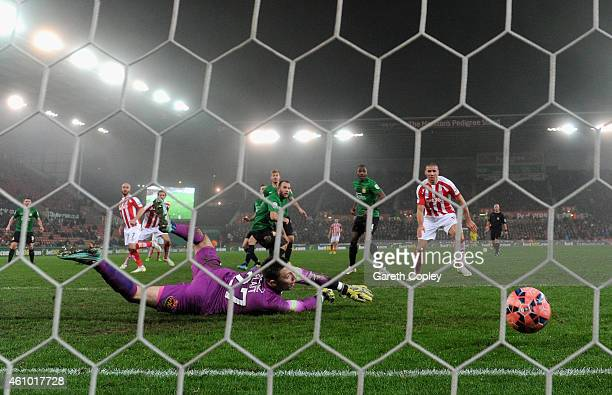 Stephen Ireland of Stoke City scores his team's second goal past Jonathan Flatt of Wrexham during the FA Cup Third Round match between Stoke City and...