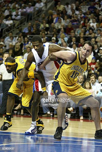 Stephen Jackson and Jeff Foster of the Indiana Pacers box out Antonio McDyess of the Detroit Pistons in Game two of the Eastern Conference Semifinals...