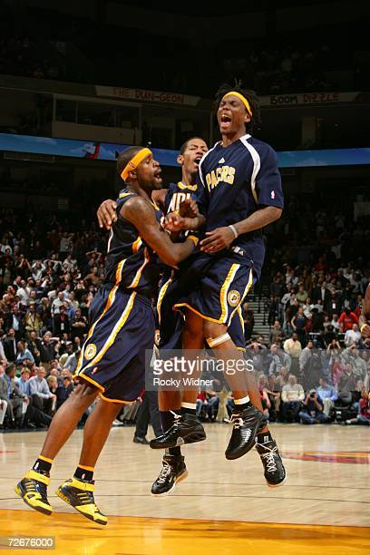 Stephen Jackson Danny Granger and Marquis Daniels of the Indiana Pacers celebrate their victory against the Golden State Warriors on November 29 2006...