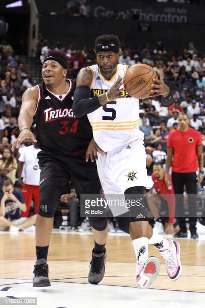 Stephen Jackson of Killer 3s handles the ball against David Hawkins of Trilogy during week four of the BIG3 three-on-three basketball league at...