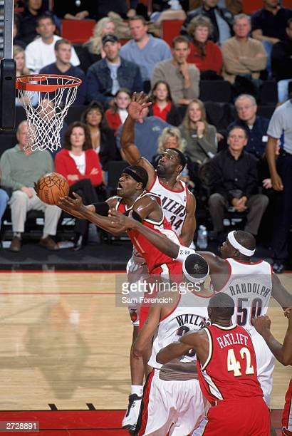 Stephen Jackson of the Atlanta Hawks drives to the basket between Zach Randolph and Dale Davis of the Portland Trail Blazers during the game at The...