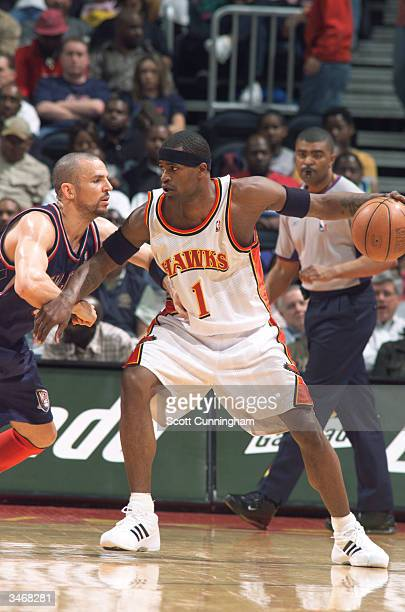 Stephen Jackson of the Atlanta Hawks posts up Jason Kidd of the New Jersey Nets during the game on April 12 2004 at Philips Arena in Atlanta Georgia...