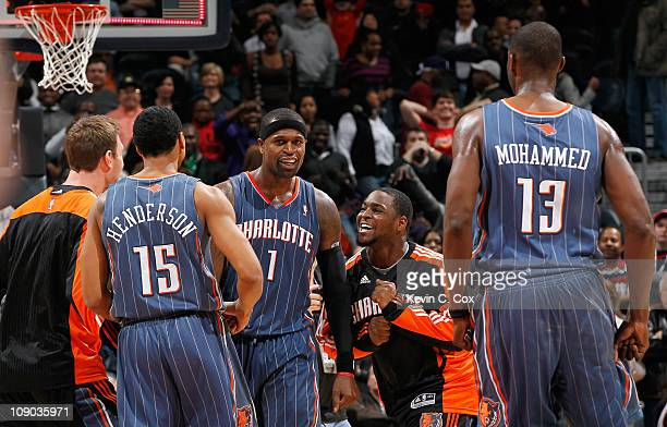 Stephen Jackson of the Charlotte Bobcats celebrates with teammates after hitting the gamewinning jumper as time expired to give the Bobcats a 8886...
