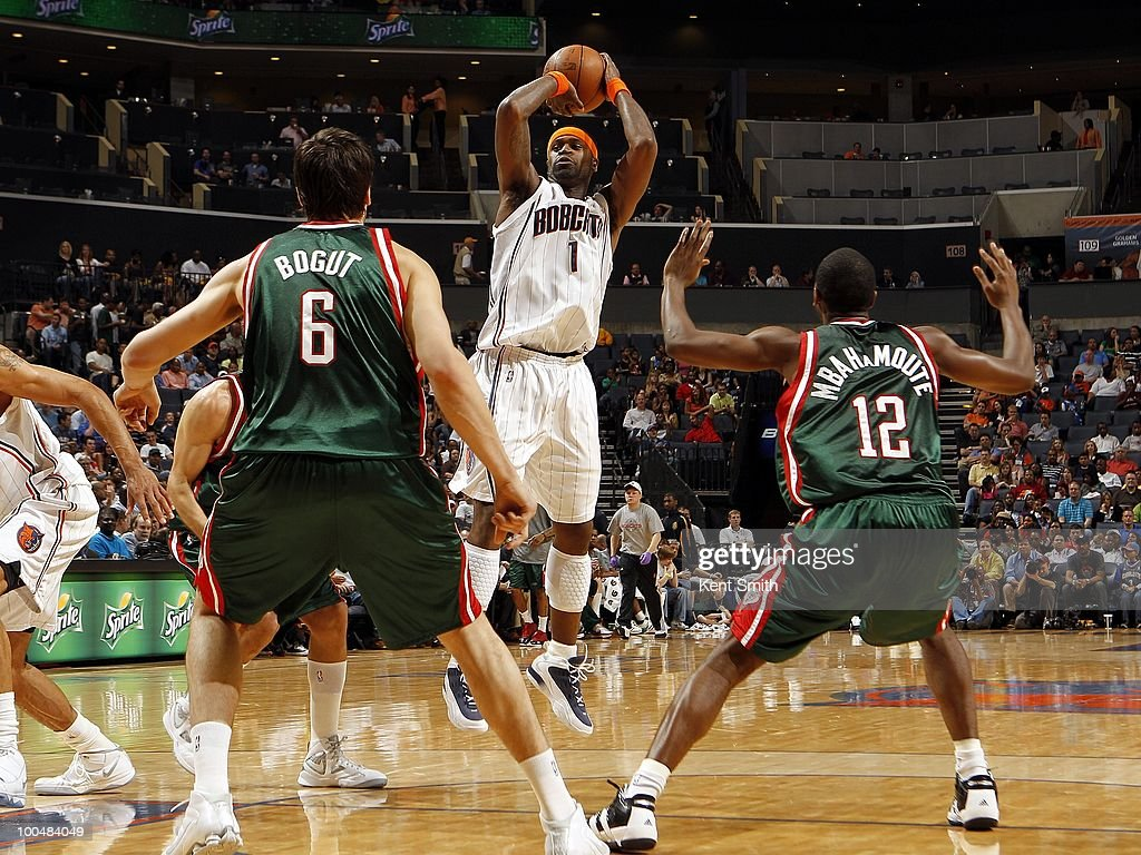 Stephen Jackson #1 of the Charlotte Bobcats shoots a jump shot against Andrew Bogut #6 and Luc Mbah a Moute #12 of the Milwaukee Bucks during the game at Time Warner Cable Arena on April 2, 2010 in Charlotte, North Carolina. The Bobcats won 87-86.