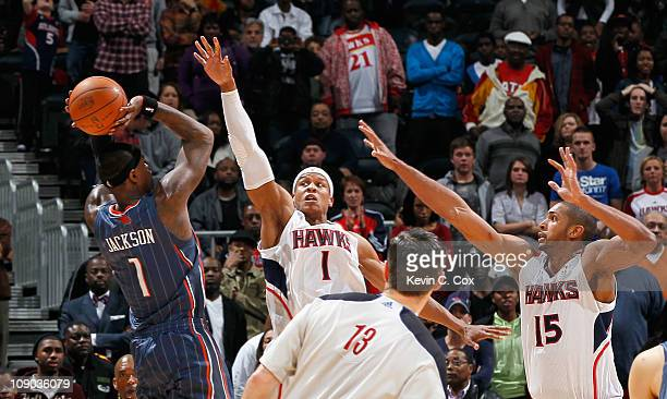 Stephen Jackson of the Charlotte Bobcats shoots the gamewinning jumper as time expires over Maurice Evans and Al Horford of the Atlanta Hawks at...
