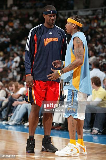 Stephen Jackson of the Golden State Warriors and Allen Iverson of the Denver Nuggets talk before their game at the Pepsi Center on March 29 2008 in...