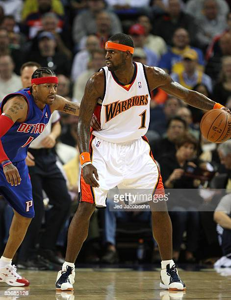 Stephen Jackson of the Golden State Warriors is defended by Allen Iverson of the Detroit Pistons during an NBA game on November 13 2008 at Oracle...