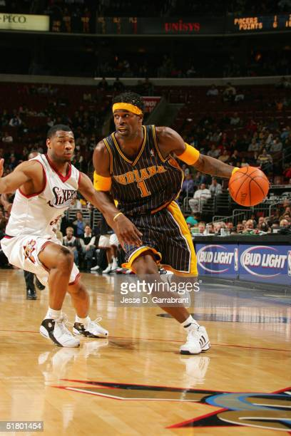 Stephen Jackson of the Indiana Pacers drives against Willie Green of the Philadelphia 76ers on November 12 2004 at the Wachovia Center in...