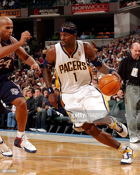 Stephen Jackson of the Indiana Pacers drives on Richard Jefferson of the New Jersey Nets on November 11, 2005 at Conseco Fieldhouse in Indianapolis,...
