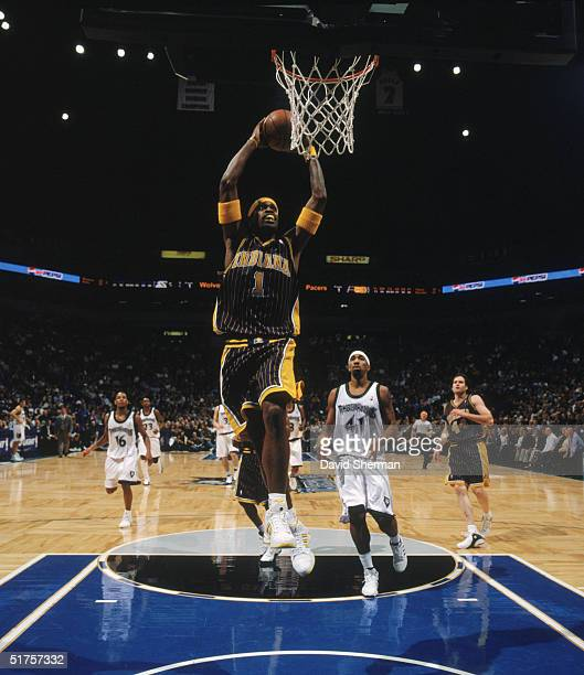 Stephen Jackson of the Indiana Pacers goes for a dunk during the game against the Minnesota Timberwolves at Target Center on November 9 2004 in...