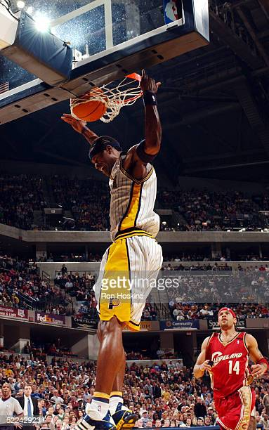 Stephen Jackson of the Indiana Pacers jams on Ira Newbie of the Cleveland Cavaliers on February 25 2005 at Conseco Fieldhouse in Indianapolis Indiana...
