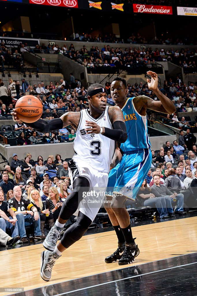Stephen Jackson #3 of the San Antonio Spurs drives against Al-Farouq Aminu #0 of the New Orleans Hornets on January 23, 2013 at the AT&T Center in San Antonio, Texas.