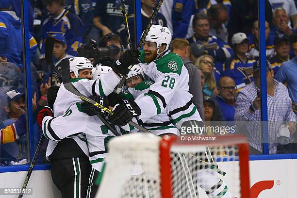 Stephen Johns of the Dallas Stars celebrates with teammates after beating the St Louis Blues in overtime in Game Four of the Western Conference...