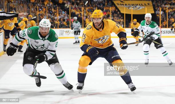 Stephen Johns of the Dallas Stars skates against Craig Smith of the Nashville Predators during an NHL game at Bridgestone Arena on October 12 2017 in...