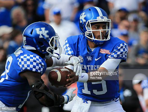 Stephen Johnson of the Kentucky Wildcats hands the ball off during the first half of the game against the Georgia Tech Yellow Jackets at EverBank...