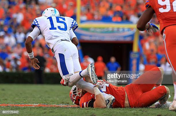 Stephen Johnson of the Kentucky Wildcats is sacked by Jarrad Davis of the Florida Gators during a game at Ben Hill Griffin Stadium on September 10...