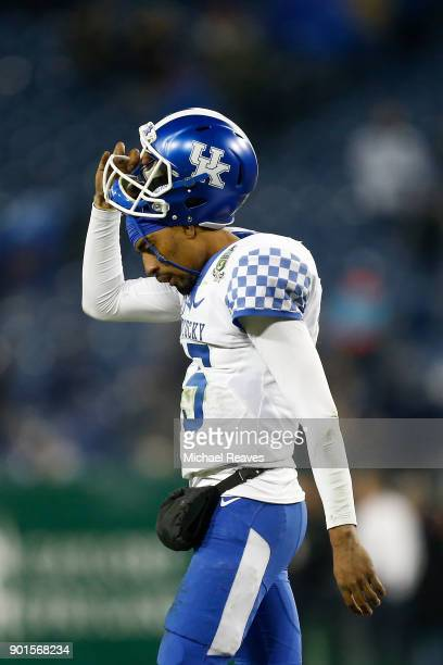 Stephen Johnson of the Kentucky Wildcats reacts after failing to convert on a gametying two point conversion against the Northwestern Wildcats during...