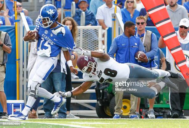 Stephen Johnson of the Kentucky Wildcats runs for a touchdown as Brentton Ervin of the Eastern Kentucky Colonels misses the tackle at Kroger Field on...