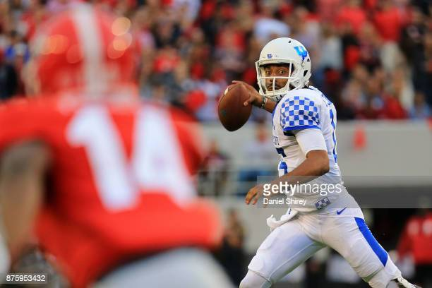 Stephen Johnson of the Kentucky Wildcats throws a pass on the run during the first half against the Georgia Bulldogs at Sanford Stadium on November...
