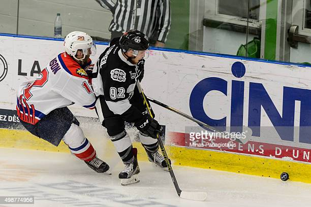 Stephen Johnson of the Moncton Wildcats and Pascal Corbeil of the Blainville-Boisbriand Armada chase the puck during the QMJHL game at the Centre...