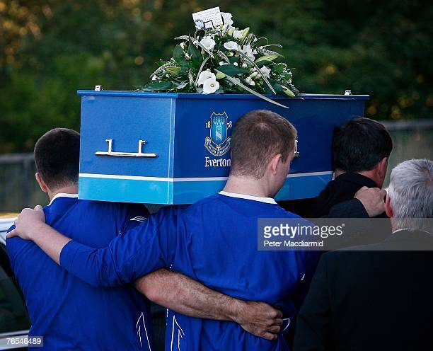 Stephen Jones carries the coffin of his murdered son Rhys with the help of his other son Owen into Liverpool Angican Cathedral for a funeral service...
