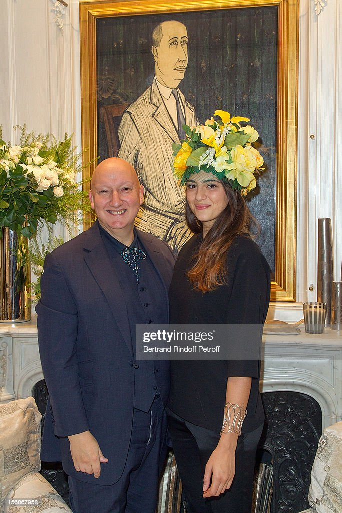 Stephen Jones, hat designer for Christian Dior fashion house, poses with Dior employee Tatiana Khayat at the Dior Boutique during the Sainte-Catherine Celebration on November 23, 2012 in Paris, France.