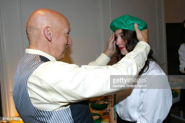 Stephen Jones hat designer for Christian Dior fashion house poses with Catherinette during Dior celebrates SainteCatherine at Dior Boutique on...