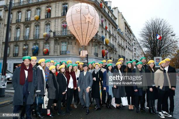 Stephen Jones hat designer for Christian Dior fashion house poses with Catherinettes and Nicolas during Dior celebrates SainteCatherine at Dior...
