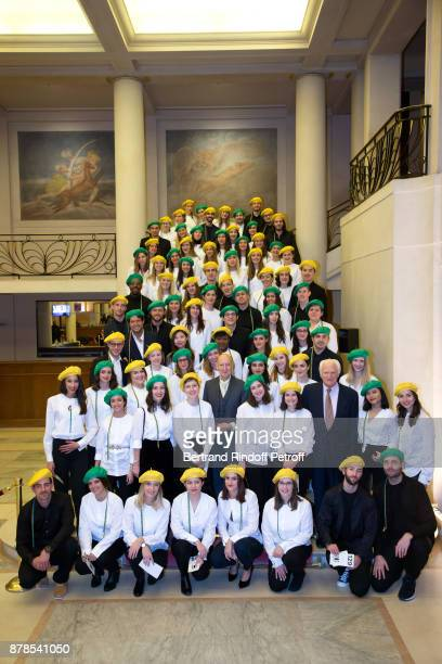 Stephen Jones hat designer for Christian Dior fashion house poses with Catherinettes and Nicolas of Dior during the 'Comite Montaigne' Celebrates...
