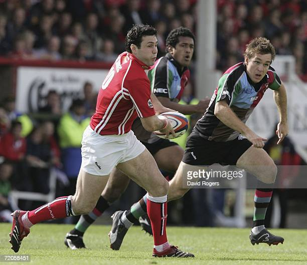 Stephen Jones of Llanelli passes the ball during the EDF Energy Anglo Welsh Cup match between Llanelli Scarlets and NEC Harlequins at Stradey Park on...