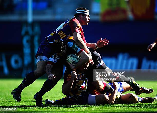 Stephen Jones of Scarlets is tackled by Knoyle Tavis, Guirado Guilhem and Mas Nicolas during the Heineken Cup Pool 5 match between Perpignan and...