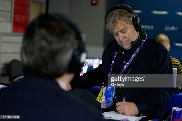 Stephen K. Bannon takes notes while listing to a caller while hosting Brietbart News Daily on SiriusXM Patriot at Quicken Loans Arena on July 20,...