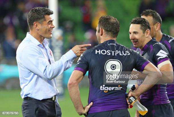 Stephen Kearney coach of the Warriors speaks with Billy Slater of the Melbourne Storm and Cameron Smith of the Melbourne Storm after the round eight...