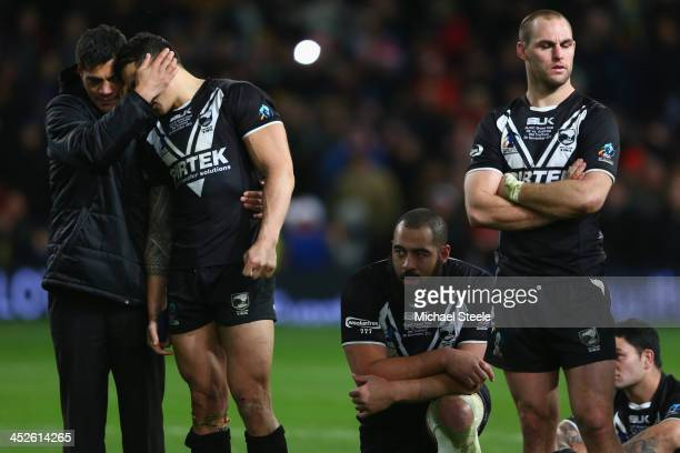 Stephen Kearney the head coach of New Zealand puts an arm around Sonny Bill Williams after his sides 234 defeat during the Rugby League World Cup...