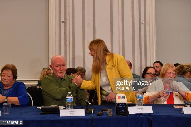 Stephen Kelly and Margaret Aspinall shake hands as family members survivors and campaigners for the victims of the Hillsborough Disaster hold a press...
